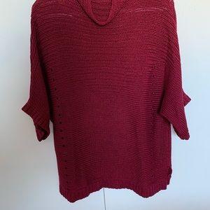 High-neck Löle Sweater. Nice raspberry color.